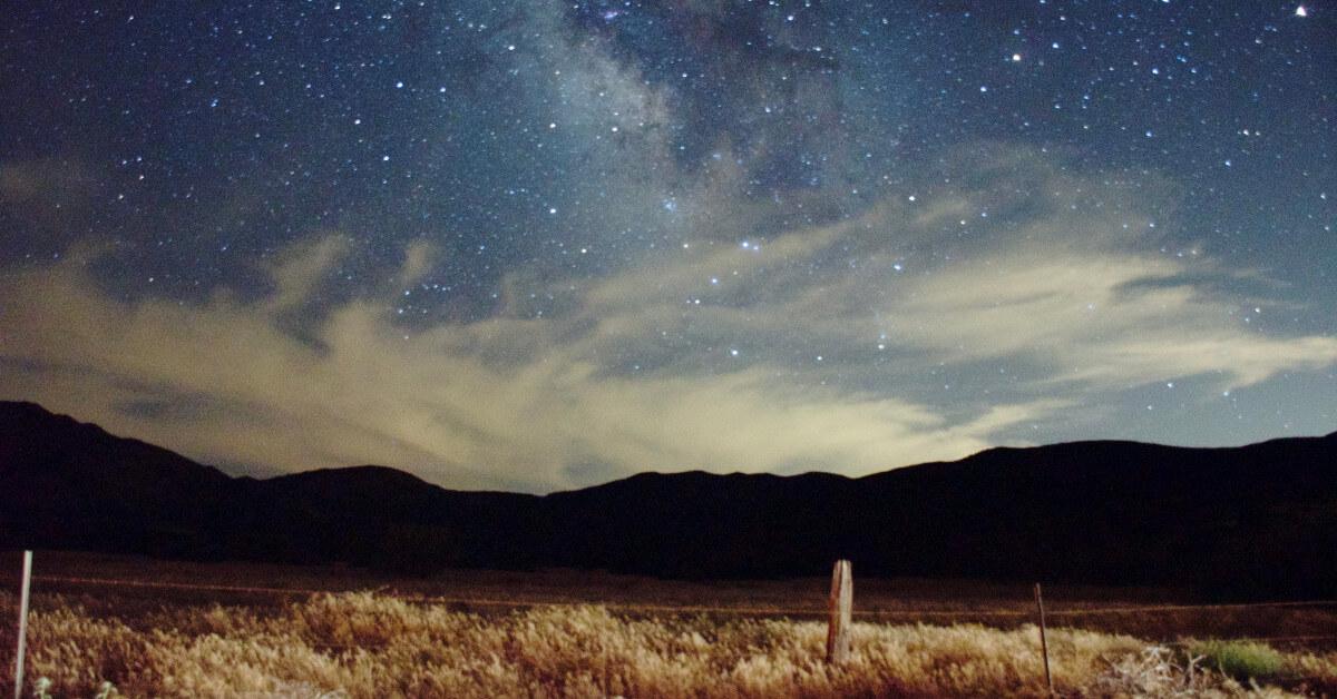 Starry sky over a field